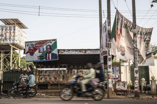 Posters for Nigeria's former military ruler and presidential candidate Muhammadu Buhari hang at an intersection in Kaduna, which was hit hard by interreligious violence during the 2011 election, on March 29, 2015. Nigeria counted ballots in its closely fought general election after failures in controversial new technology pushed voting into a second day, with officials calling for calm in the tense wait for a winner. AFP PHOTO / NICHOLE SOBECKI