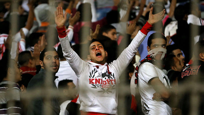 An Ultras White Knights soccer fan cries during a match between Egyptian Premier League clubs Zamalek and ENPPI at the Air Defense Stadium in a suburb east of Cairo, Egypt. Image source sbs