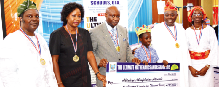 Director General, National Mathematical Centre, Abuja, Prof Adewale Solarin, (left); wife of the Vice Chancellor, Covenant University, Mrs. Ayo; the vice chancellor, Prof Charles Ayo; winner of the TUMA prize, Master Akinleye Akinfoluhan Akintobi; Chairman of The Ambassadors Schools, Mr. Samson Yomi and the wife, Mrs Victoria Osewa during the TUMA prize giving ceremony