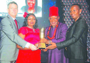 Managing DirectorNigerian Breweries Plc, Nicolaas Vervelde (left),;  National Champion of the Distributors Award 2015, Dem Joy Igwe and Sir Gabriel Igwe of Ifeoma Chukwuka Nigeria Limited; and the  Nigerian Breweries Managing Director's wife, Clementine Vervelde   at the Distributors' Award in Lagos...recently.
