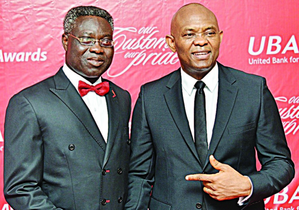 Group Managing Director/Chief Executive Officer, UBA Plc, Philips Oduoza (left); and Chairman, UBA Plc, Tony Elumelu, at the annual UBA Chief Executive Officer Awards organised by the Bank in Lgaos at the weekend.