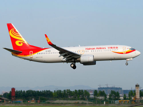 """Hainan Airlines Boeing 737-800 B-2158 CTU 2011-7-7"" by Mjordan 6 - http://www.airliners.net/photo/Hainan-Airlines/Boeing-737-84P/2021154/L/. Licensed under CC BY-SA 3.0 via Wikimedia Commons."