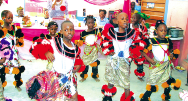 Pupils of Gift Jewels International School, Lagos, doing Ekombi dance from Cross River State, during the school's 2015 Cultural Day cele