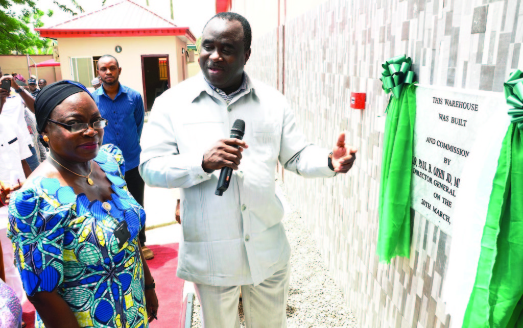 Director-General, Dr. Paul Orhil (right) and Director, Administration and Human Resource, Mrs. Yetunde Onibothof National Agency for Food Drug Administration and Control (NAFDAC)at the Commissioning of NAFDAC UltraModern Warehouse held at NAFDAC Office, Oshodi, Lagos last week