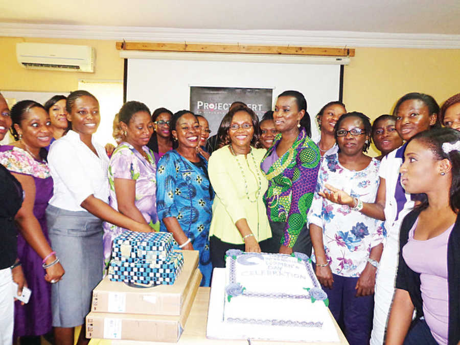 Executive Director, Project Alert, Dr. (Mrs.) Josephine Effah-Chukwuma (middle) with Human Resources Director, Alcatel-Lucent Nig. Ltd., Mrs. Adebimpe Ayo-Elias (on her left), and other participants at the event