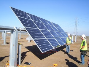 Workers installing solar panels.   //Image source: whartonjournal.com