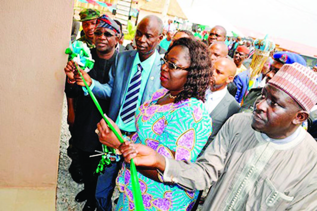 The Chairman of Sparklight Property Development Company Limited, Chief Toyin Adeyinka (left); Ogun State Commissioner for Housing; Mr. Daniel Adejobi, Minister for Lands, Housing and Urban Development, Dr. (Mrs) Akon Eyakenyi and Managing Director of Federal Mortgage Bank of Nigeria, Alhaji Gimba Ya'kumo at the commissioning of Rockview Estate, Obasanjo Hilltop, Abeokuta, Ogun State, last week