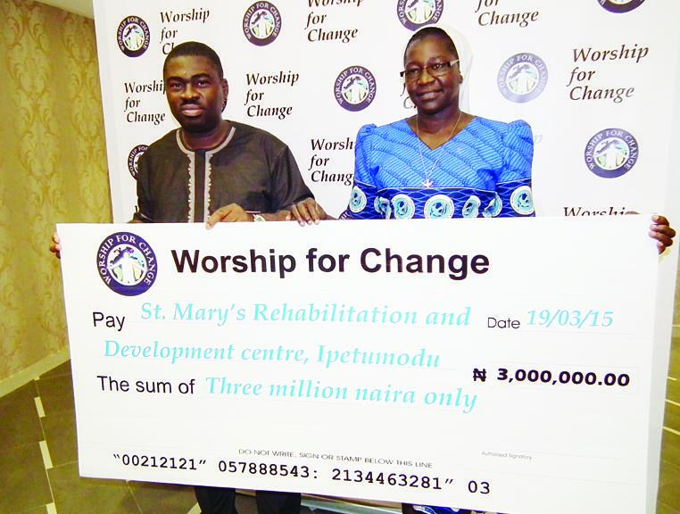 Convener, Worship for Change, Wale Adenuga, and Rev. Sis Elizabeth Kehinde, Coordinator, St Mary's Rehabilitation and Development Centre, Ipetumodu, Osun State, during presentation of cheque to the Centre in Lagos yesterday, being proceeds from last edition of Worship For Change.