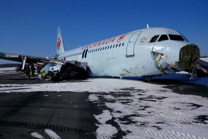 PHOTO: The damaged Air Canada plane after it skidded off the runway. (Reuters: Transportation Safety Board of Canada)
