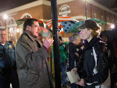 FERGUSON, MO - MARCH 13: James Knowles, the mayor of Ferguson, Missouri, visits with pro-police demonstrators outside of the police station on March 13, 2015 in Ferguson, Missouri. PHOTO: AFP