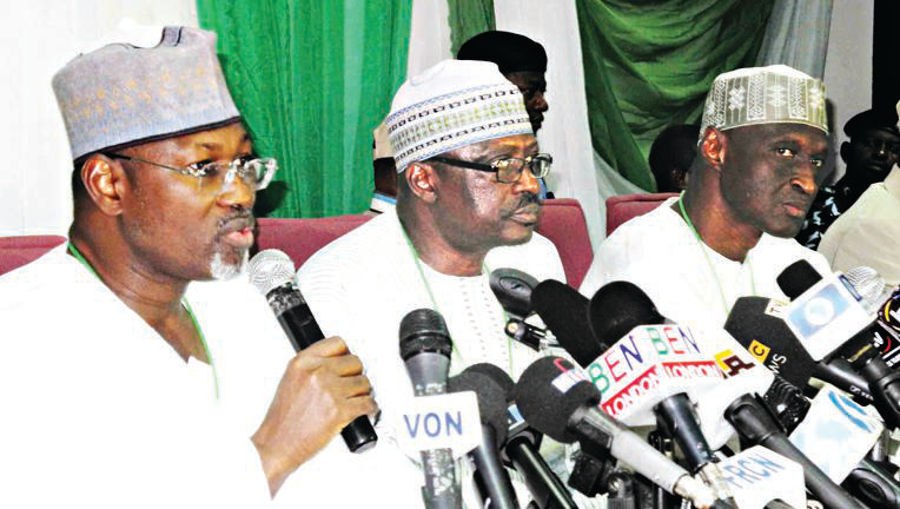 Chairman, Independent National Electoral Commission (INEC), Prof. Attahiru Jega (left); Commissioner in-charge of Information, Chris Iyimoga and INEC Commissioner, Mr. Mohammed Hammanga, during Jega's press conference on the 2015 Presidential and National Assembly Elections in Abuja… yesterday. PHOTO: NAN