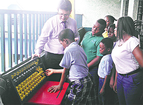 Director-Training, EduSoft Associates Ltd, Devesh K. Varrier (left), taking pupils of Princeton College, Surulere, Lagos State, through their paces during an educational training/presentation of abacus programme at the school while a teacher watches on...recently