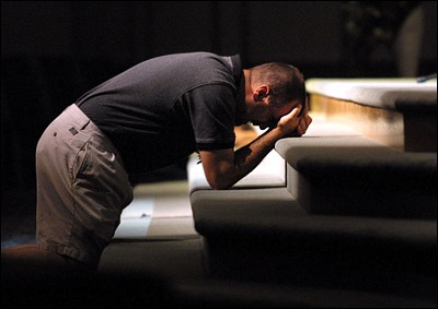 Praying man at the altar. Image source erikbrewer
