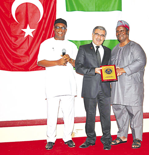 Chief Executive Officer, National Mathematical Centre (NMC), Prof Adewale Solarin (right), Group Managing Director, Nigeria Turkish International Colleges (NTIC), Mehmet Basturk and Chairman of Governing Council of West African Examinations Council, Daniel Uwazurike, duringthe presentation of NMC 2014 Awards to Basturk at the Sheraton Hotels, Abuja…recently