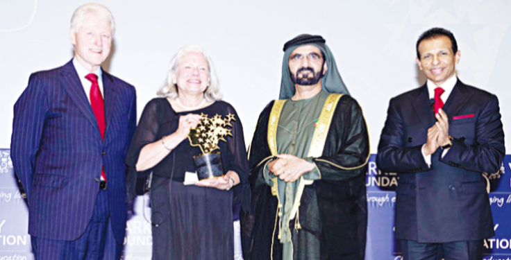 Former President of the United States, Bill Clinton (left), teacher, Nancie Atwell, from the United States; His Highness Sheikh Mohammed bin Rashid Al Maktoum, the Vice President/Prime Minister of the United Arab Emirates and ruler of Dubai, and Sunny Varkey of the Varkey Foundation (left) after Atwell received her Global Teacher Prize award from Clinton in Dubai during the Global Education and Skills Forum (GESF)...on Saturday