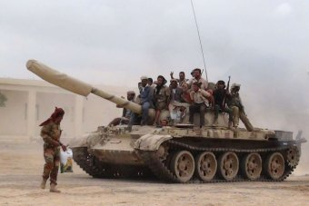 Militants loyal to Yemen's president move a tank from the al-Anad air base in the country's south on March 24, 2015. Image source abc