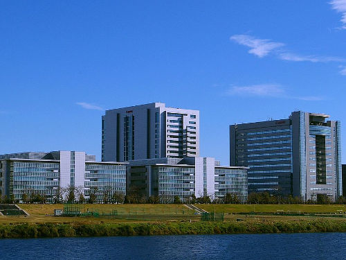 """""""Canon headquarters Ota, Tokyo distant"""" by 上野彦馬Watermark removed by Beao - Own work. Licensed under CC BY-SA 3.0 via Wikimedia Commons."""