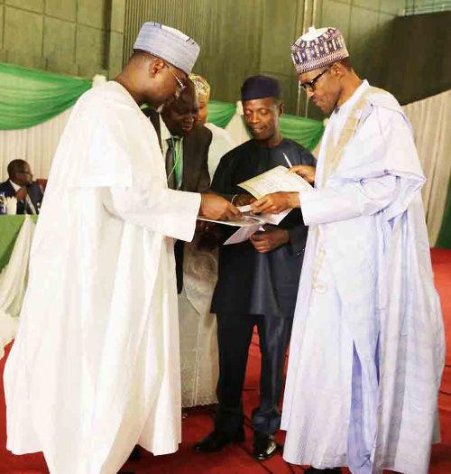 INEC presents certificate of return to General Buhari in Abuja