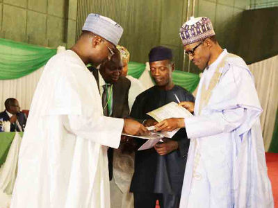 Buharing receiving certificate from Jega
