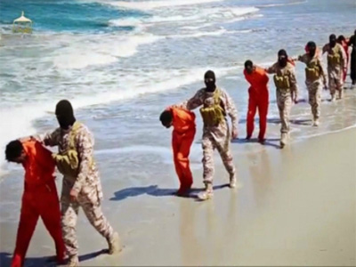 This undated image made from a video released by Islamic State militants, Sunday, April 19, 2015, appears to show the killing of a group of captured Ethiopian Christians in Libya. (Photo: AP)