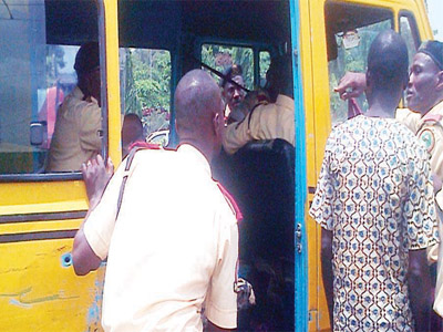 LASTMA officials apprehending a commercial bus driver on Agege Motor Road yesterday PHOTO: Isaac Taiwo