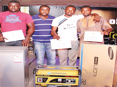 L-R Solution Oguniyi, winner of a brand new refrigerator, Funsho Ayeni, Senior Brand Manager, Stout and Life, Nigeria Breweries, Adekunle Adeyinka, winner of a 5.9KVA generator, and Moshood Abiola, winner of a brand new LED TV at the Legend Taste and Tell Activation held at the Gentlemen's Quarters, Ibadan, Oyo State recently.
