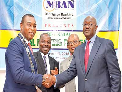The re-elected President of MBAN, Dr. Femi Johnson (left); Executive Secretary/CEO, Mr. Kayode Omotosho; Vice president, Mr. Ber\n Akaneme and Member of Voard of Trustees/Acting Chairman of National Electoral Committee of MBAN, Mr. Adeoye Mapaderun during the 2015 bi-ennial general meeting