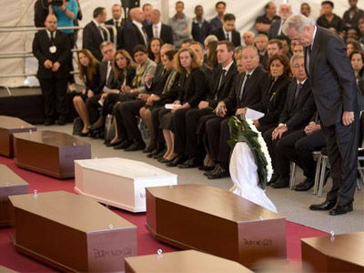 EU commissioner for Migration Dimitris Avramopoulos stands during a funeral service for 24 migrants drowned while trying to reach the Southern coasts of Italy, in Msida, in the outskirts of Valletta, Malta, Thursday, April 23, 2015.