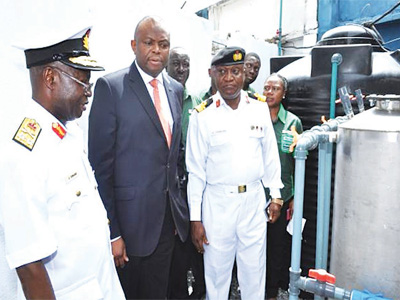 Commander, Naval Medical Centre, Rear Admiral Jeremiah Onubi (left); MD/CEO, Fidelity Bank Plc. Nnamdi Okonkwo and Admiral Superintendent, Naval Dockyard Limited, Rear Admiral Sylvanus Chinweuba at the commissioning of the water treatment plant, computers and other office equipment donated by staff of Human Resources Division of Fidelity Bank yesterday.