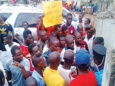 Youths of Oke-Ira community, protesting irregular power supply at the community's undertaken office.