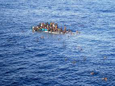 A boat carrying migrants in the Mediterranean Sea on April 12, 2015 (Reuters)