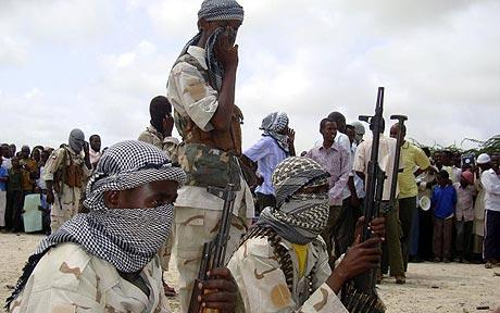 Al-Shabaab fighters provide security during a demonstration in Suqa Holaha neighborhood in Mogadishu, Somalia Photo: AP