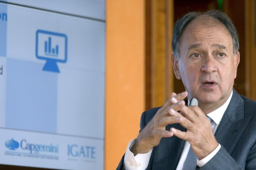 President of the Capgemini company Paul Hermelin gives a press conference on April 27, 2015 at the Capgemini headquarters in Paris. French IT services and consulting company Capgemini said today it was buying New Jersey-based IGATE for $4 billion (3.7 billion euros), boosting its US-generated business to 30 percent of its total activity. AFP PHOTO / KENZO TRIBOUILLARD