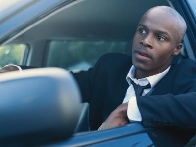 Man inside a car. Image source blackenterprise