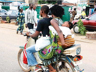 A woman  with a baby on an Okada