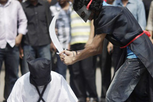 Suspected jihadists beheading a man