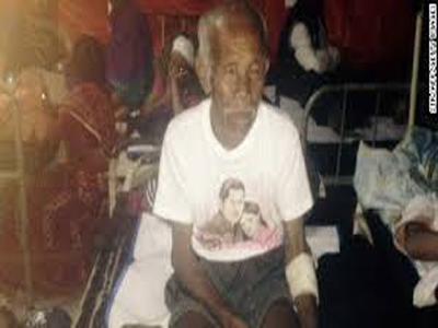 Funchu Tamang, 101, sitting at a hospital in Nuwakot district yesterday after being rescued from his collapsed home.