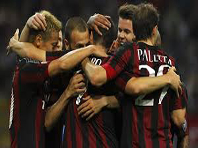 Players of AC Milan celebrating after a goal. PHOTO: fifa.com