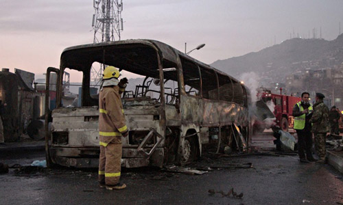 A member of the Afghan emergency services stands at the scene of a suicide attack on an Afghan army bus in Kabul. Photograph: Hedayatullah Amid/EPA