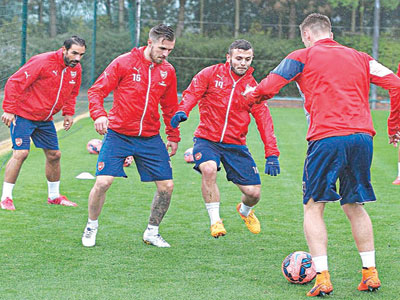 Set For Villa…Arsenal players Aaron Ramsey (second left), Jack Wilshere (centre) and Calum Chambers training ahead of today's FA Cup final.