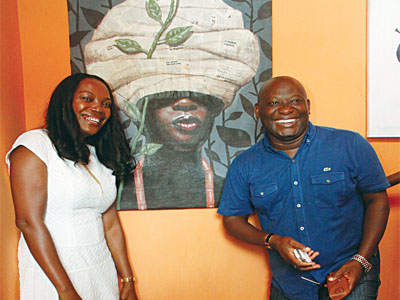 Nwuke and Pablo Amaran at the exhibition, behind is Joseph Eze's work titled, Turban