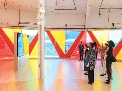 Visitors viewing Hassan Khan's various works at Intervention 2014-15 at Sharjah Biennnal 12                                                                                                                        Photo: Deema Shahin