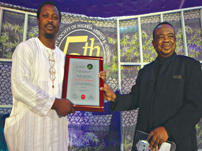 Akpovi-Esade (left) and COSONboss Okoroji