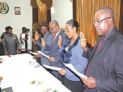 Governor Willie Obiano of Anambra State (left), swearing in five new members into his cabinet at the  Governor's Lodge, Amawbia, on Monday:  Commissioner for Information, Dr Mary Imelda O. Nwogu (2nd left); Housing, Frank Emeka Offor; Agriculture, Afamefuna Chinedu Mbanefo; Special Duties, Barrister Uzoamaka Gladys Ilobi; and Finance, Sir Okey Moka,