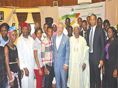 New Chairman, Nigerian Conservation Foundation, Ede Dafinone (right), President, Philip Asiodu and Council Member, Desmond Majekodunmi with NCF Conservation Club members during the 25th Annual General Meeting in Lagos, recently