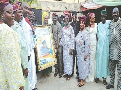 Members of  YESSOSA  and other well wishers presenting a gift to the new DIG Adeola Adeniji with his wife,Fausat ( middle) at the event