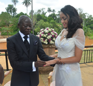 Governor Adams Oshiomole slips a ring on the finger of former Miss Iara Fortes at a private marriage registry at Iyamho, Etsako West Local Government Area of Edo State, on Friday