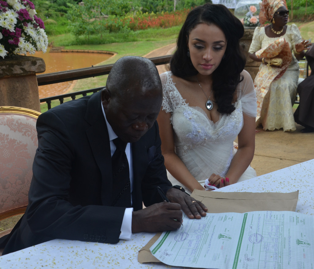 Governor Adams Oshiomole signs the dotted lines at the wedding
