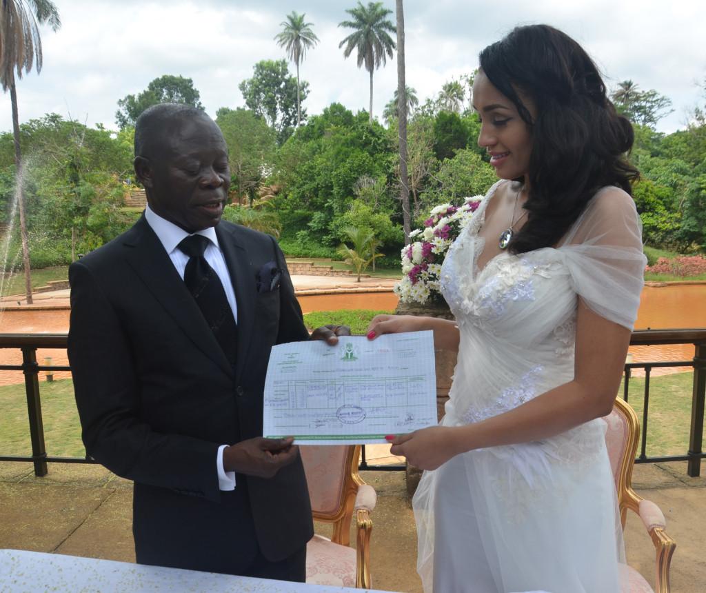Mr. and Mrs Adams Oshiomole display their wedding certificate