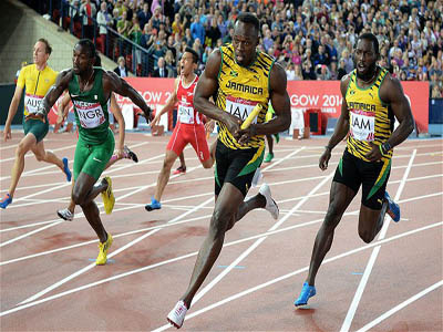 Egwero (left in green) competing with Jamaica's Bolt and others years ago.